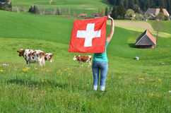 Girl holding the Swiss flag Stock Photo
