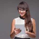 Girl holding tablet Royalty Free Stock Photo