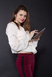 Girl holding a tablet computer Stock Image