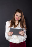 Girl holding a tablet computer Stock Photo
