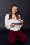 Girl holding a tablet computer Stock Photos