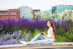 Girl holding tablet computer outdoors Stock Photos