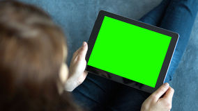 Girl Holding Tablet PC on Blue Stock Photo