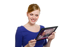 Girl holding a tablet pc und uses the video chat Stock Photography