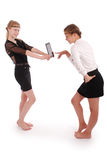 Girl holding the tablet PCs and the other girl nazhymaye it Royalty Free Stock Photo