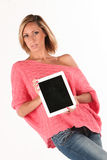 Girl holding a tablet Royalty Free Stock Photos