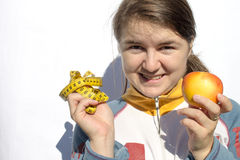 Girl holding tape measure and apple Stock Photography