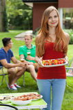 Girl holding tasty food Royalty Free Stock Image