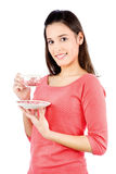 Girl holding a teapot. Young brunette girl holding a teapot, isolated on white background Stock Image