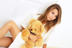 Girl holding a teddy bear Stock Photos
