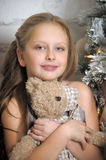 Girl holding a teddy bear Stock Photography