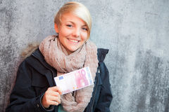 Girl holding ten euro note Royalty Free Stock Images