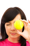 Girl holding tennis ball. Girl holding  tennis ball on the white Stock Images