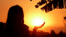 Girl Holding The Sun Royalty Free Stock Photography