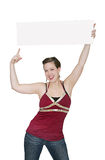 Girl holding thin sign. Attractive young woman holding a large blank sign Royalty Free Stock Images