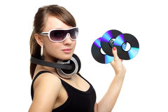 Girl holding three CD Royalty Free Stock Photo