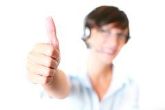 Woman with thumbs up wearing headset and glasses Stock Images