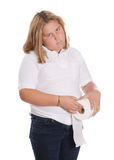 Girl Holding Toilet Paper. A young girl holding a roll of toilet paper, isolated against a white background Stock Images