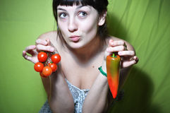 Girl holding tomato and pepper Royalty Free Stock Photo
