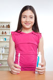 Girl Holding Toothbrush and Tooth Paste Royalty Free Stock Images