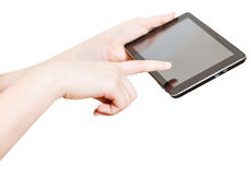 Girl holding and touching touchpad screen isolated Stock Photography
