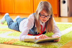 Girl  holding a touchpad tablet Stock Images