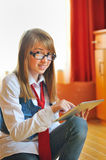 Girl  holding a touchpad tablet Royalty Free Stock Photography