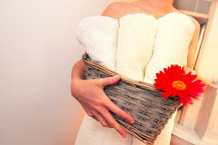 Girl holding towels and flower, waiting for massage Royalty Free Stock Images