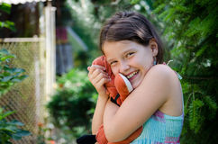 Girl holding a toy Stock Photo