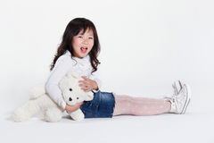 Girl holding toy bear Royalty Free Stock Photography