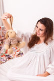 A girl holding a toy rabbit Royalty Free Stock Image