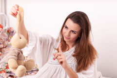 A girl holding a toy rabbit Royalty Free Stock Photography