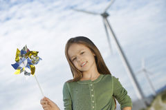 Girl Holding Toy Windmill Stock Images