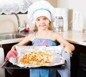 Girl holding tray with pizza Stock Photos