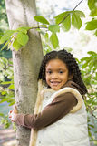 Girl holding a tree Stock Images