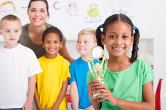 girl holding trophy Stock Photography