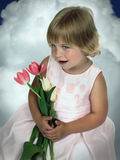 Girl holding tulips Royalty Free Stock Images