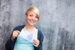 Girl holding twenty euro Royalty Free Stock Photos