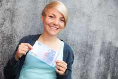 Girl holding twenty euro Royalty Free Stock Images