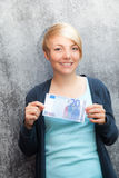Girl holding twenty euro Stock Photo
