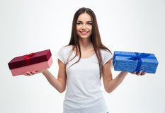 Girl holding two gift boxes Royalty Free Stock Photos