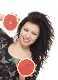 Girl holding two half of grapefruit Royalty Free Stock Images