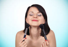 Girl holding two makeup brush Royalty Free Stock Photography