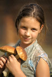 Girl holding two  mushrooms Stock Image