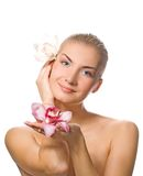 Girl holding two orchids Royalty Free Stock Photography