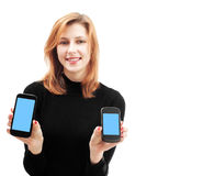 Girl holding two smartphone Royalty Free Stock Photography