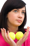 Girl holding two tennis balls Royalty Free Stock Photo
