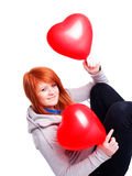 Girl holding two valetine balloon hearts Stock Photography