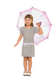 Girl holding umbrella. Beautiful girl with long blonde hair and short bangs standing under an umbrella - Isolated on white background Royalty Free Stock Images