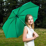 Girl holding an umbrella Royalty Free Stock Images